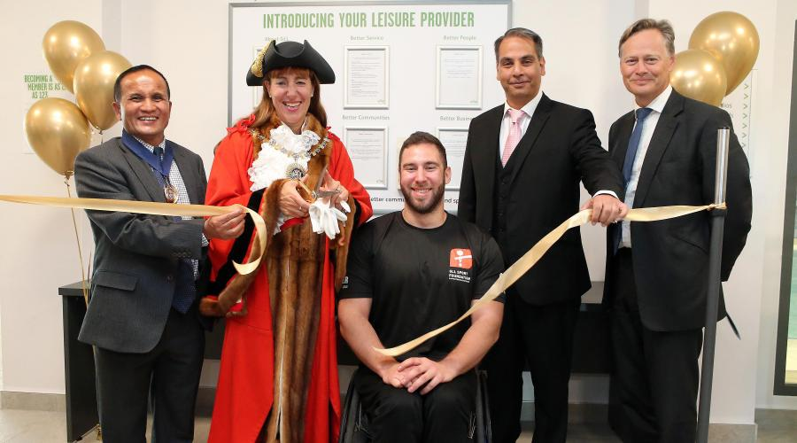The Worshipful Mayor of Barnet, Councillor Caroline Stock, cuts the ribbon to officially open Barnet Copthall Leisure Centre.