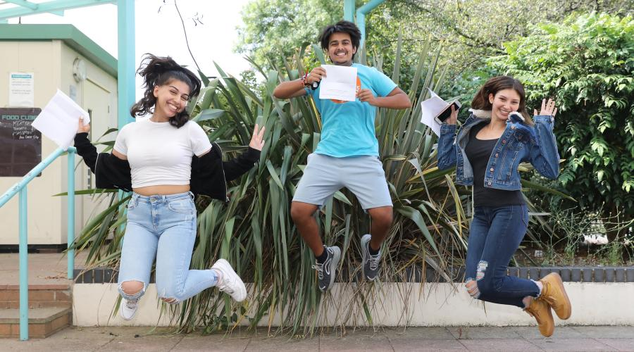 A socially distanced celebration: Students from The Compton School jump for joy after receiving their results