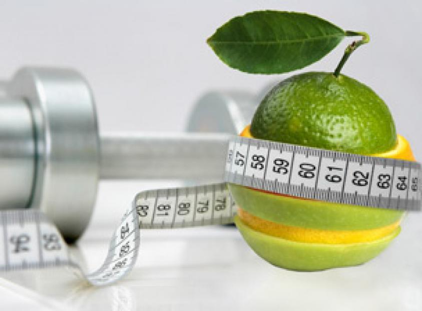 image of healthy fruit, tape measure and dumb-bell