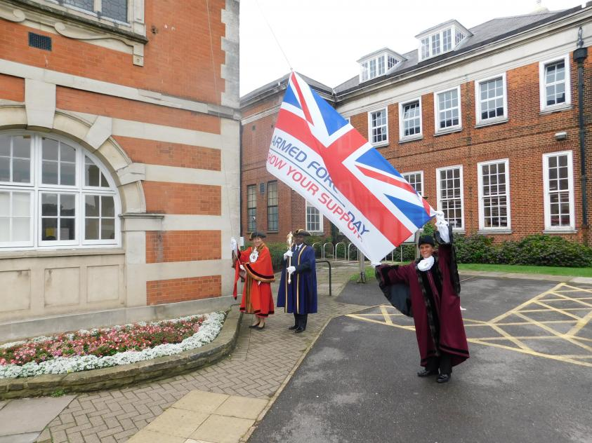 The Worshipful Mayor of Barnet, Councillor Caroline Stock, and Deputy Mayor, Councillor Lachhya Bahadur Gurung, raise the Armed Forces flag outside the Town Hall for Armed Forces Week.