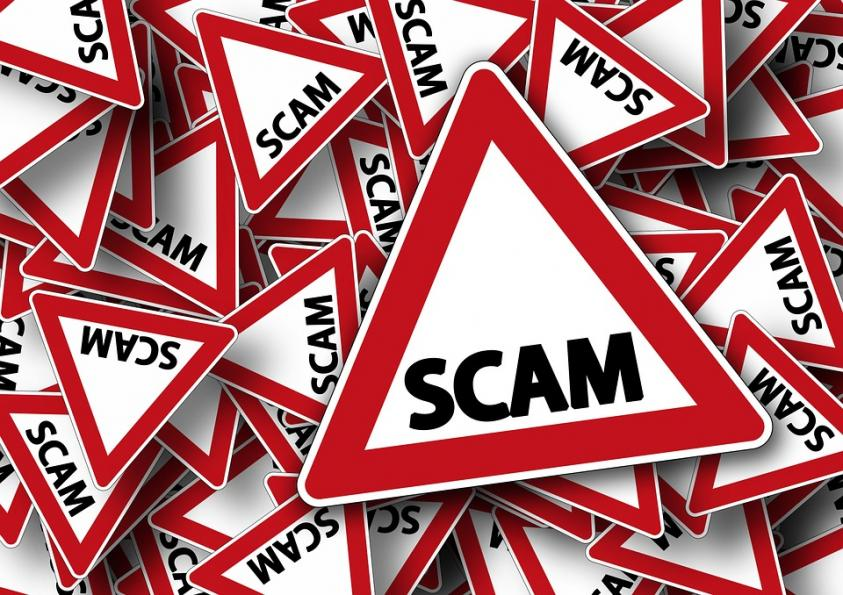 Image of scam warning signs